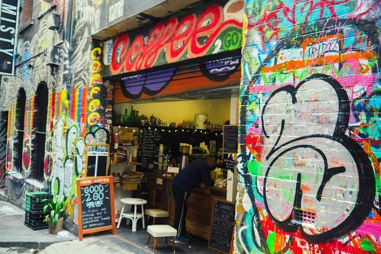 Image of coffee counter in Melbourne laneway surrounded by street art