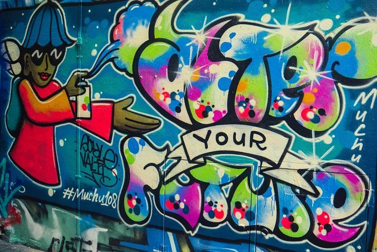"Image of brightly coloured character with spray can spelling ""after your future"" street art in Melbourne"