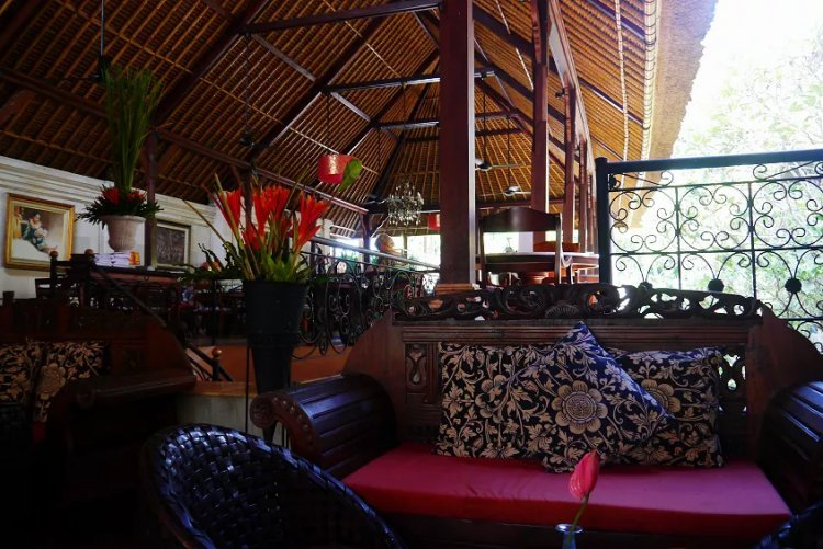 Image of intricately decorated cosy interior of cafe in Bali