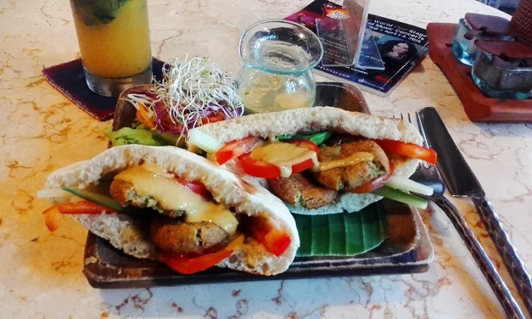 Image of falafel and vegetables in pitta bread