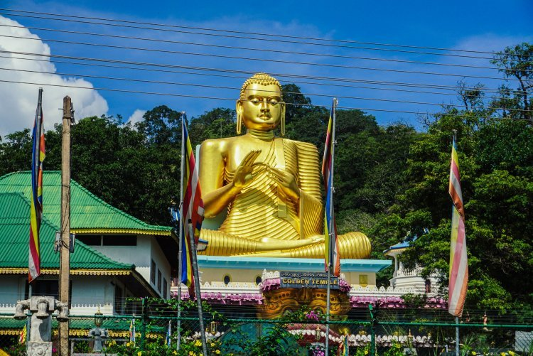 Image of huge gold buddha statue outside temple in Kandy Sri Lanka