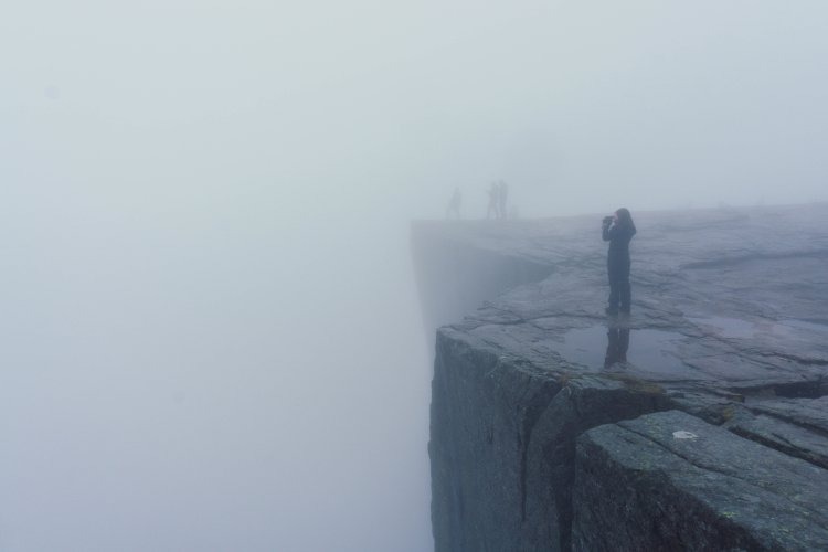 Image of the top of Pulpit Rock in the dense fog with no view of the fjords in sight
