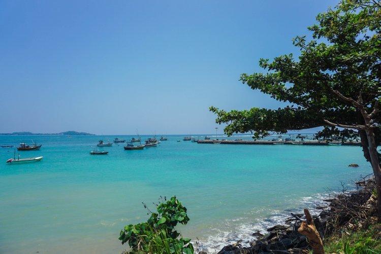 Image of fishing boats on turquoise sea in Unawatuna Sri Lanka