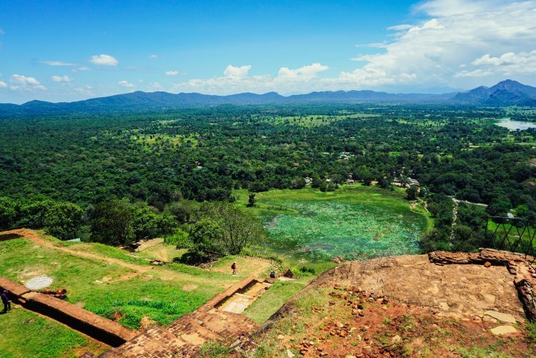 Image looking out over the surrounding lake and mountains from the top of Sigiriya Rock in Sri Lanka