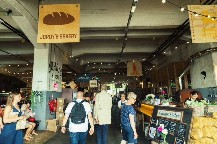Image of the the inside of the indoor food market Fenix Food Factory in Rotterdam