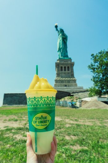 Image of Statue of Liberty lemonage cup with State of Liberty in background