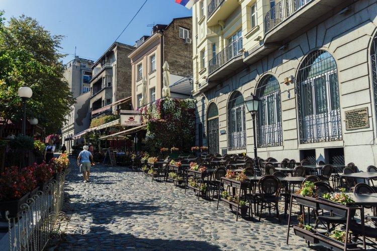 Cobbled street lined with restaurants in bohemian area of Skadarlija in Belgrade, Serbia