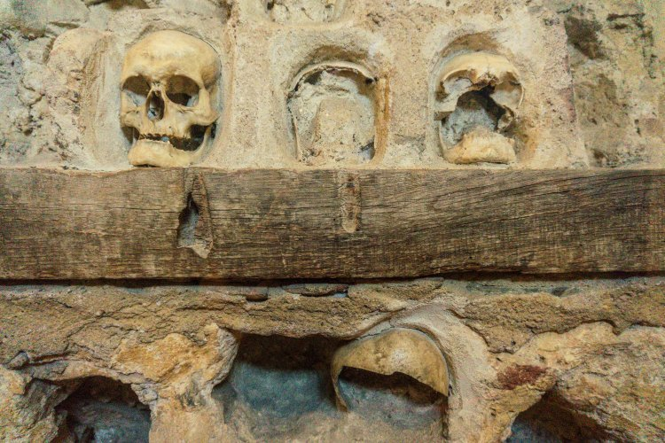 Close up on skulls in the wall of Skull Tower in Niš, Serbia